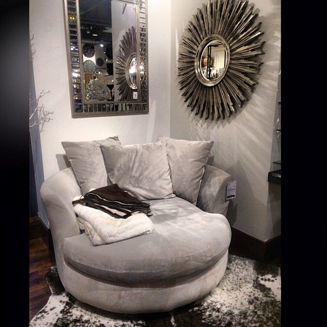 Our Cuddler Chair, Ayi Faux Cowhide Rug, Avila Mirror, and Fairmont Mirror make for a comfy nook in @newlywed143's home. #ComfyChair #CowhideRugs
