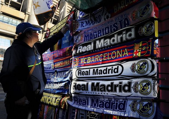 A fan looks at a merchandise stall prior to the La Liga match between Real Madrid CF and FC Barcelona at estadio Santiago Bernabeu on March 23 2014...