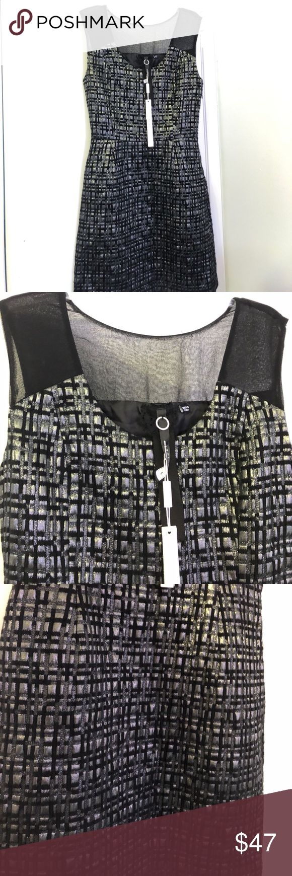 NWT Poleci Black Metallic Sheath Cocktail Dress Brand new!!! Amazing jacquard material. Metallic silk print. Black with sparkle and shimmer. Black silk panel contrast. Sleeveless. Great for the office or after work party. Poleci Dresses