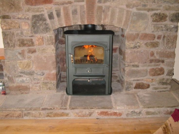 Cool A Clearview Solution installed into a traditional brick fireplace by Kernow Fires in Cornwall