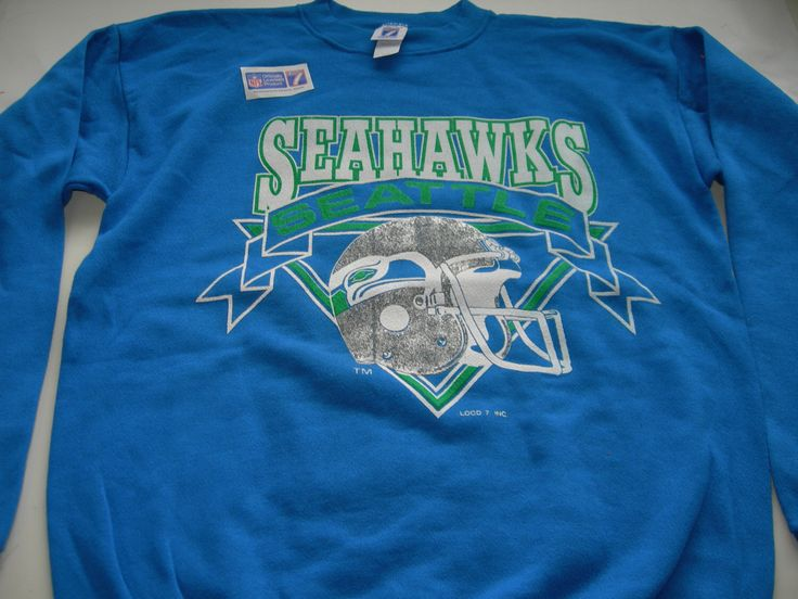 Vintage Seattle Seahawks NFL sweatshirt by LOGO 7 made in the USA New with tags   officially licensed product , by workingclassrebel on Etsy https://www.etsy.com/listing/485050781/vintage-seattle-seahawks-nfl-sweatshirt
