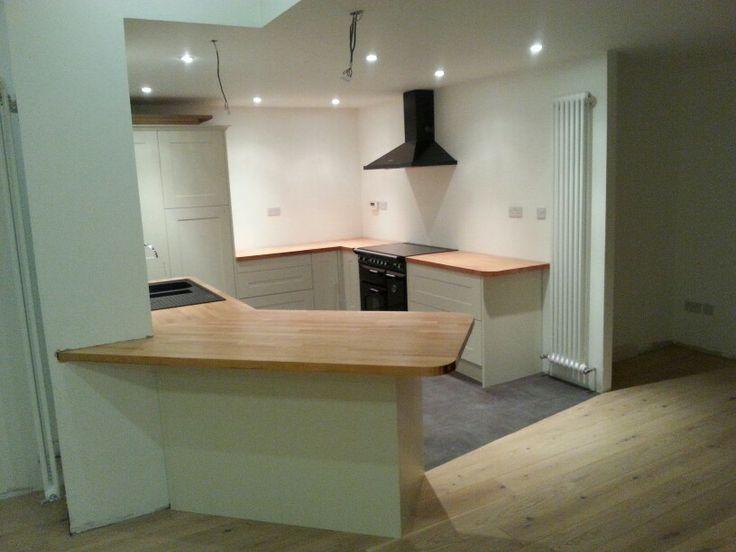 Schreiber kitchen. Forza radiator. White oak waxed floor. Dark tile vinyl. Beech countertop. Black Rangemaster.