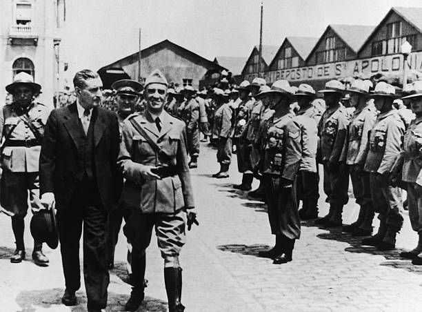 Portuguese dictator Antonio De Oliveira Salazar reviews troops about to embark for the African colonies of the Portuguese Republic circa 1950