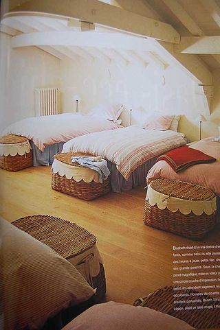 Bunk attic ... such a great space for all the kids at Christmas...love the baskets