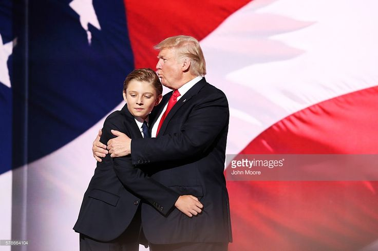 Republican presidential candidate Donald embraces his son Barron Trump after he delivered his speech on the fourth day of the Republican National Convention on July 21, 2016 at the Quicken Loans Arena in Cleveland, Ohio. Republican presidential candidate Donald Trump received the number of votes needed to secure the party's nomination. An estimated 50,000 people are expected in Cleveland, including hundreds of protesters and members of the media. The four-day Republican National Convention…
