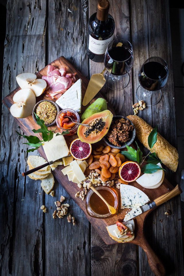 Create a stunning winter cheese board with honey, dried fruits and citrus marmalades, like blood orange.