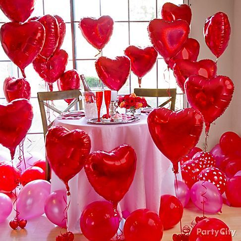 Arrange heart balloons around the room at different heights using balloon weights to create an amazing setting for a romantic Valentines Day table for two