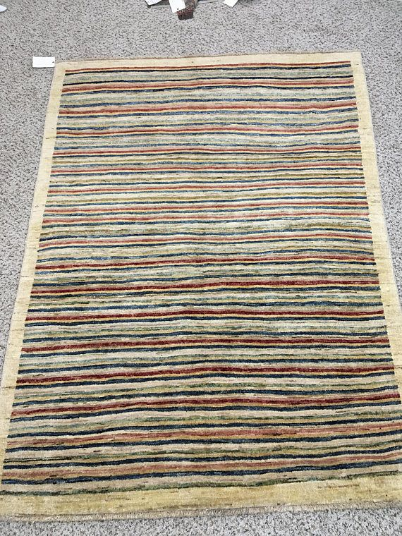 Gabbeh Beige Rug -> Origin: Pakistan -> Dimensions: 61 x 45 Feet -> Total Sqft: 27.6 -> Hand Knotted Rug -> SKU: 1180 Khan Oriental Rugs is one of the leading Rugs and Carpets store in whole Frederick, MD. We have years of extensive experience in providing wide range of vintage rugs and carpets which mainly includes; Tribal Salmon Rugs, Belgique Red-Blue Rugs, Sutri Salmon-Beige Rugs, Antique-Akfasta Blue-Beige Rugs, Agra Red-Blue Carpet, American Sarooq Salmon red Carpet, ch...