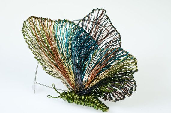 Wire sculpture art, butterfly brooch, olive green jewelry, large brooch pin, Christmas, unique bridesmaid gift, coat brooch, modern boho  Handmade wire sculpture art butterfly, large brooch pin, made of colored copper and silver wire. The height of the olive green, contemporary sculptural jewelry, unique bridesmaid gift, is 10cm (3.94in) and the width (body with wings), of the modern boho, winter coat brooch, Christmas gift is 7.5cm.(2.95in)The pin is handmade silver.