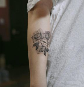 Blackwork roses on forearm by Anastasia Slutskaya