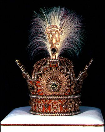 The Pahlavi Crown  This crown was used by Reza Shah, the founder of the Pahlavi dynasty, in his coronation on 25 April 1926. His son, Mohammad Reza Shah Pahlavi, the last Shah of Iran, also used the crown in his coronation on 26 Oct. 1967.The crown made of red velvet, gold, and silver. It has a total height of 29.8 cm. and has a width of 19.8 cm. It weighs 2,080 grams. The are 3,380 diamonds employed on the crown, totalling 1,144 cts. The largest is a brilliant-cut yellow diamond of 60 cts.