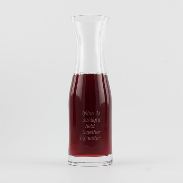 Glass Carafe 1L - This lovely crystal glass decanter has smooth clean lines. Typically used for wine or water it holds 1L. Pouring wine into a carafe prior to serving allows the wine to breath and aerate, bringing out the aromas and flavours.  Perfect for the table when entertaining for dinner or brunch.