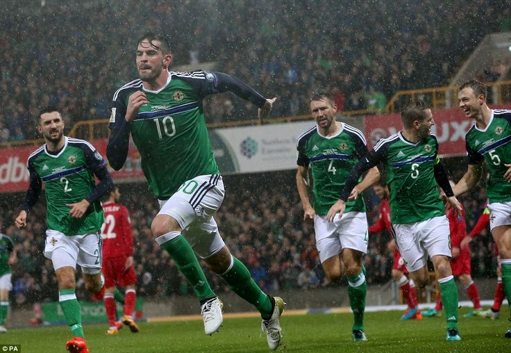 Kyle Lafferty wheels away in celebration after opening the scoring for Northern Ireland against Azerbaijan at Windsor Park