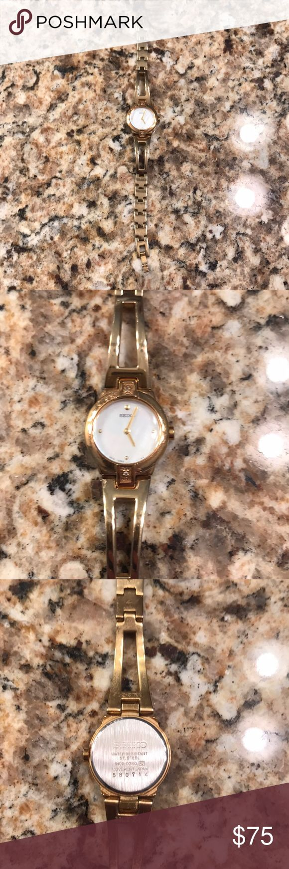 Seiko Watch Gold Seiko Pearl/Diamond Watch  - worn a few times (no signs of major wear) - pearlized face - smaller face  - needs battery -smoke free home Seiko Jewelry