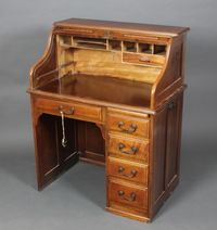 "Lot 1050 A Victorian mahogany roll top desk fitted 1 long drawer flanked by 2 short drawers with brass swan neck drop handles 45 1/2""h x 36""w x 24""d, est £150-250"