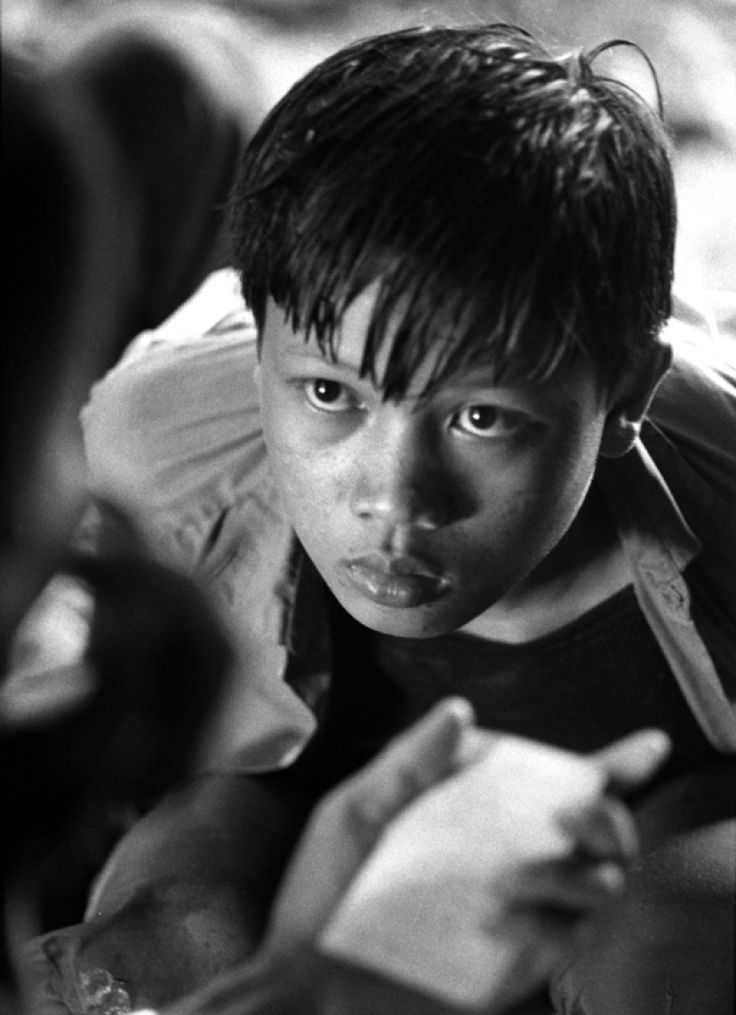 A young North Vietnamese Army soldier captured by ARVN troops is questioned, 1970.