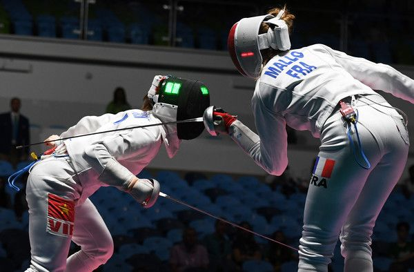 Vietnam's Thi Nhu Hoa Nguyen (L) competes against France's Auriane Mallo during their womens individual epee qualifying bout as part of the fencing event of the Rio 2016 Olympic Games, on August 6, 2016, at the Carioca Arena 3, in Rio de Janeiro.. / AFP / Kirill KUDRYAVTSEV