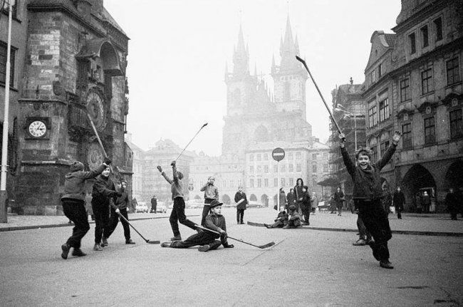 Kids playing hockey in Old Town Square-Prague