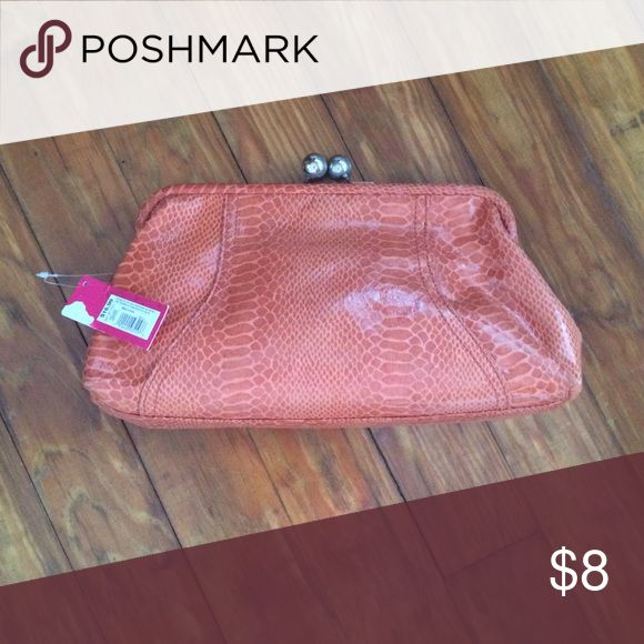NWT orange clutch bag Add a pop of color to your fall outfits with Brand new orange vegan snakeskin clutch. Xhilaration Bags Clutches & Wristlets