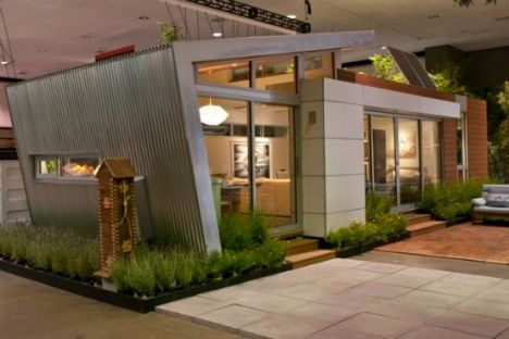 This eco-friendly prefabricated house, designed by architect Jonathan Davis, with interiors by sustainability expert Zem Joaquin, was featured at the The Dwell on Design Expo in Los Angeles. The prefab house, consisting of 520 square feet, was sold on eBay with proceeds going to Global Green USA.Green Home, Minis House, Modern Living, Living Room Design, Design Interiors, Guest House, Home Interiors Design, Design Home, Modern Interiors
