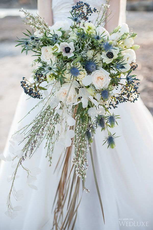 Beautiful bouquet which includes roses, thistles, viburnum, anemone and eustoma.