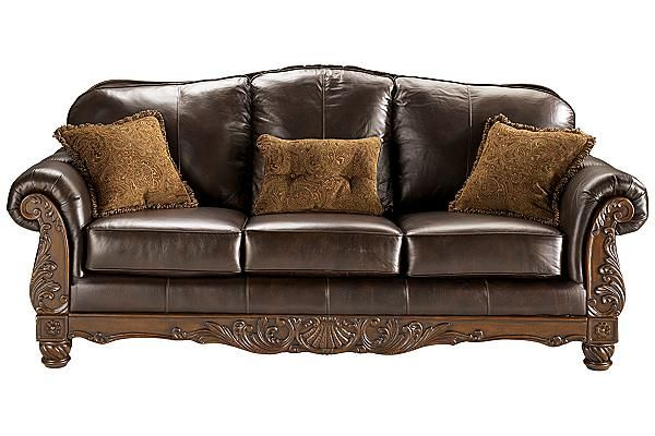 The North Shore - Dark Brown Sofa from Ashley Furniture HomeStore (AFHS.com). All leather upholstery in North Shore leather, featuring the luxurious look and feel of top quality leather, offered with some protection.