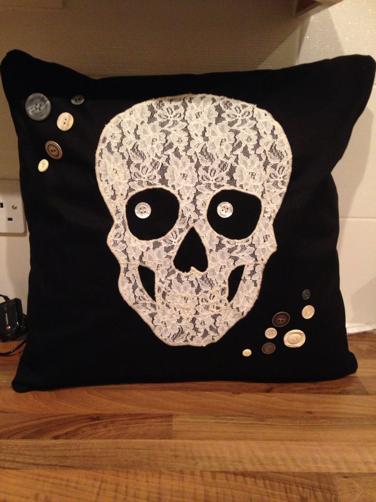 Appliqué skull lace cushion