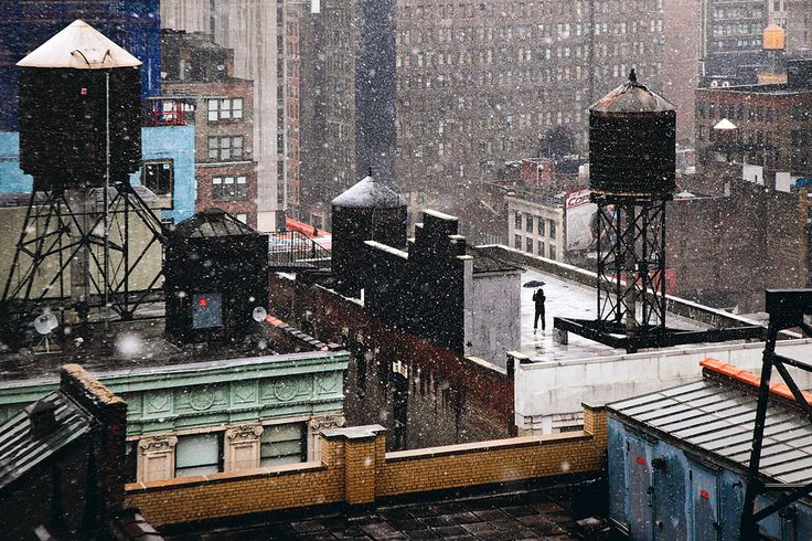 on a nyc roof, watching the snow - christophe jacrot