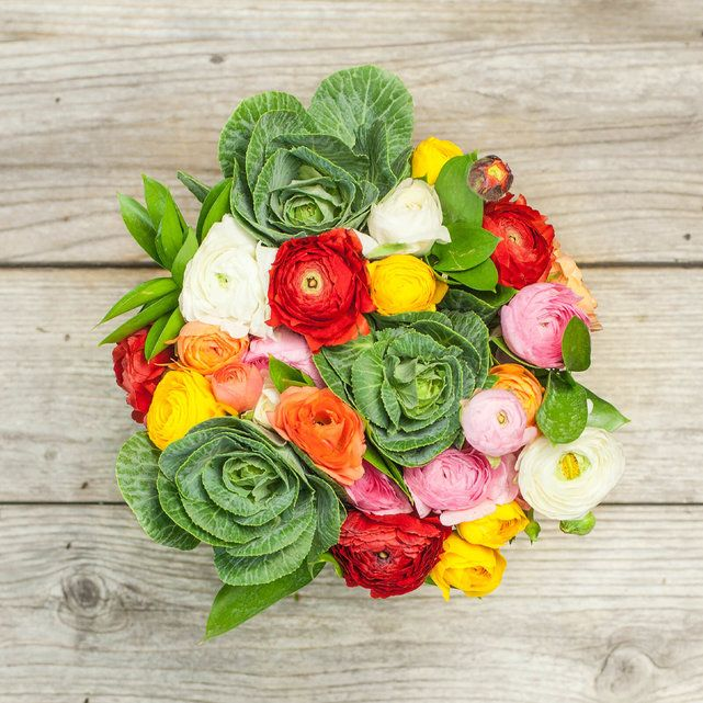 This colorful Bouq contains a mix of beautiful ranunculus with kale accents. Send flowers sustainably grown on an active volcano! Free Delivery Tues-Fri.