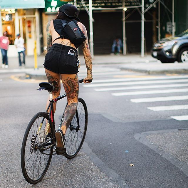 Something so strong, aggressive and explosive about this young lady on the bike (a bike messenger maybe?) She just seems like a ball of energy!                                                                                                                                                                                 Plus