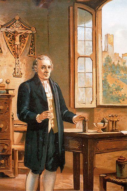 """""""Volta nel suo laboratorio"""", Arturo Ferrari, olio, 1899  La scoperta del potenziale di contatto tra metalli è un contributo molto importante, infatti l'unità di misura della differenza di potenziale elettrico (il Volt) prende il nome da Alessandro Volta."""