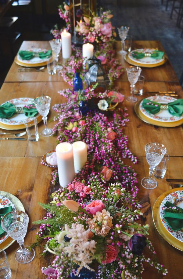A Floral Table Runner in Heather, Anemones, Astilbe, and Wildflowers | Nicole Marie Photography | See More! http://heyweddinglady.com/boho-brewery-wedding-inspiration-in-rich-jewel-tones/