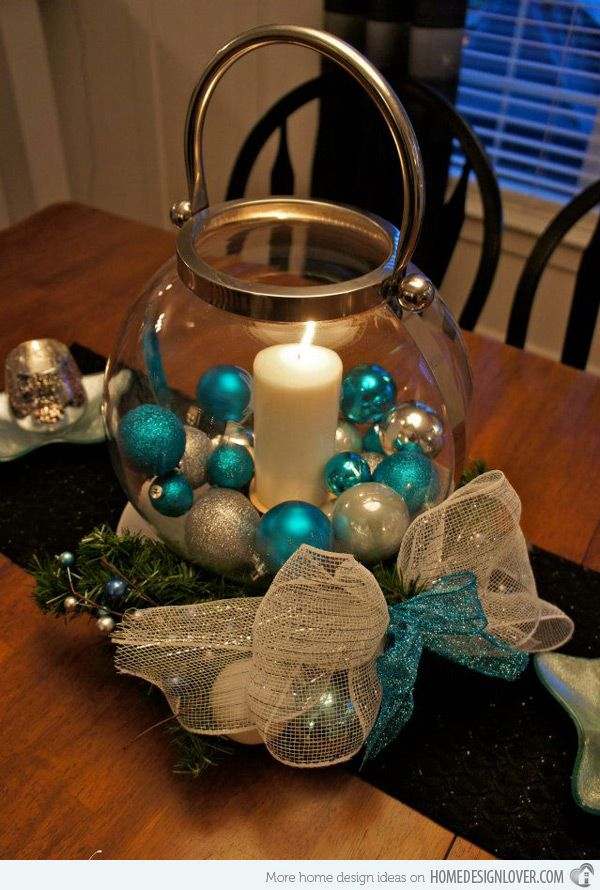 Doesn't this glass lantern like vase look stunning with the sliver and blue balls in it? This is one sample of a simple centerpiece that sure is stunning.