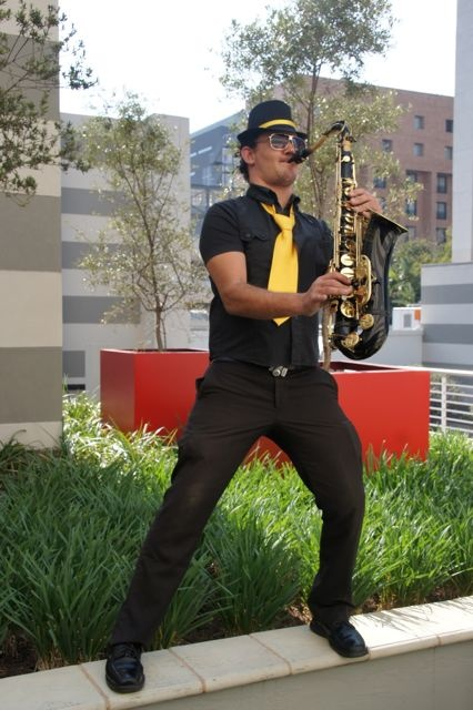 Live roaming music - saxophonist with black & yellow outfit