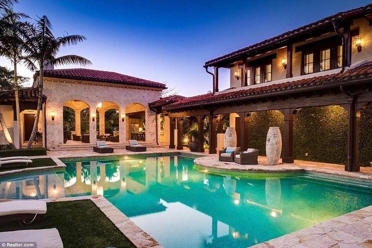The spectacular home sits on 25,834-square-foot of land and boasts luxurious features including this outdoor saltwater swimming pool