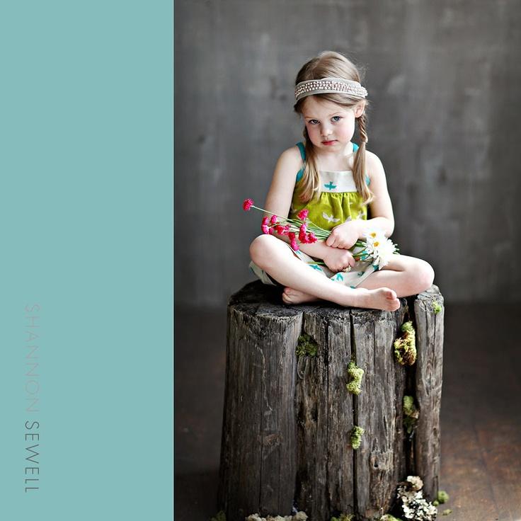 a stump as a photo prop