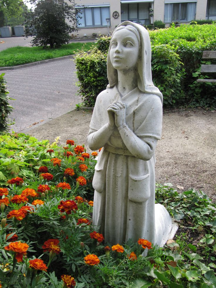 Statue of saint Bernadette Soubirous in the Lourdes grotto at Leos Oord