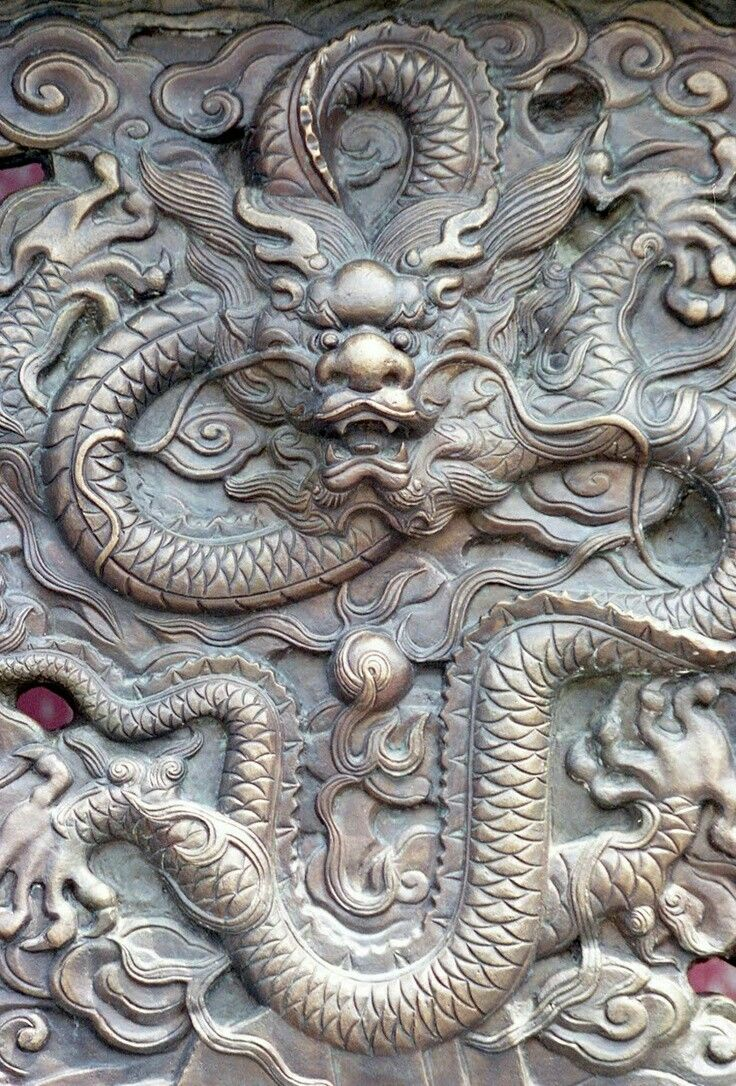 This is a piece of artwork of a dragon inside the Forbidden city that some people say gives people comfort or a feeling of protection.