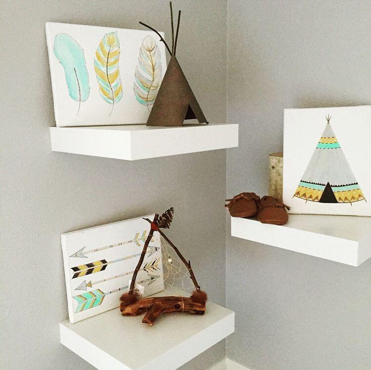 Gray, white and orange baby nursery. Woodland Native American teepee. White ikea wall shelves