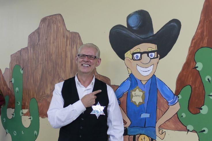 Pastor Steve standing next to his likeness in Faithville