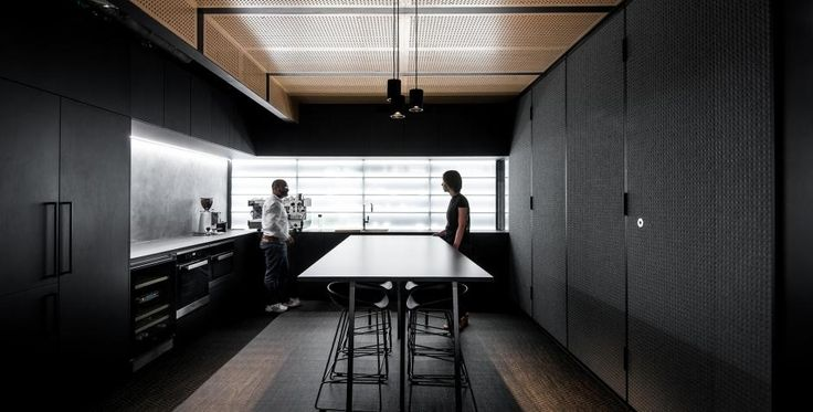The Hillam Architects office cafeteria is a perfectly designed and inspiring gathering place for the team, featuring Décor Systems' acoustic DecorZen perforated panelling range in the ceilings to achieve an industrial chic sophistication || Hillam Architects, Perth