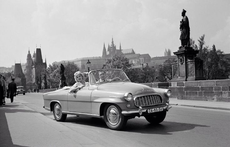 A Skoda car passes Charles Bridge in Prague. Nowadays, vehicles are not allowed to cross the bridge.