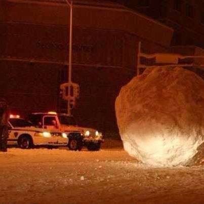 Too funny!  Somebody in Norwich, CT made this huge snow ball and put it in the middle of the street!  That must have took a while to make!