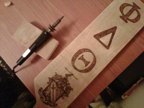 Woodburning for Phi Delta Theta in Toronto, ON by Alannah Dymond