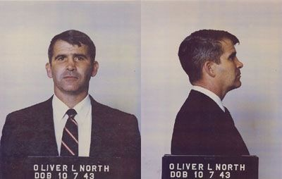 Oliver North.  Wins the prize for best posture in a mugshot.