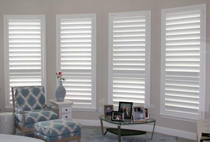 Real wood plantation shutters in the master bedroom make the room feel cool and calm.
