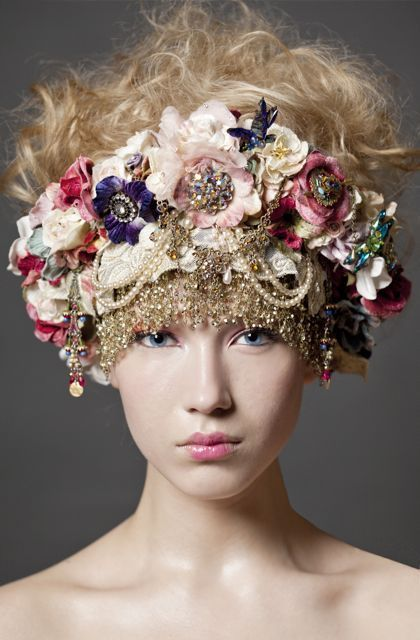 this headdress is beautiful! My favorite part of this one is the gems that have been used  as the faces of the flowers. the different array of colours that they've used in the main part. the pearls are also a nice detail.