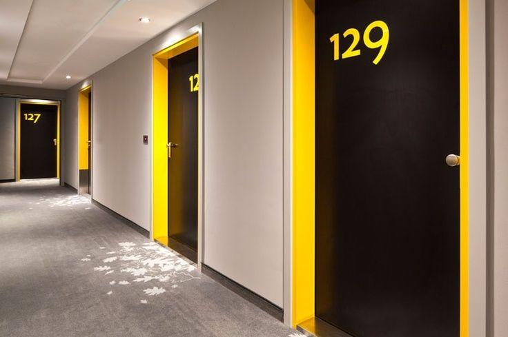 corridor with color pop at doors