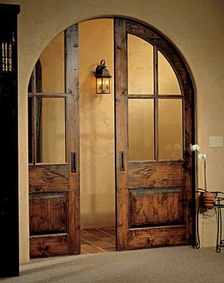 Love these walnut pocket doors. And the arched doorway.