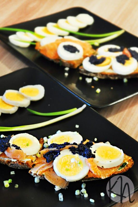 Sandwiches with egg, salmon, horseradish and caviar